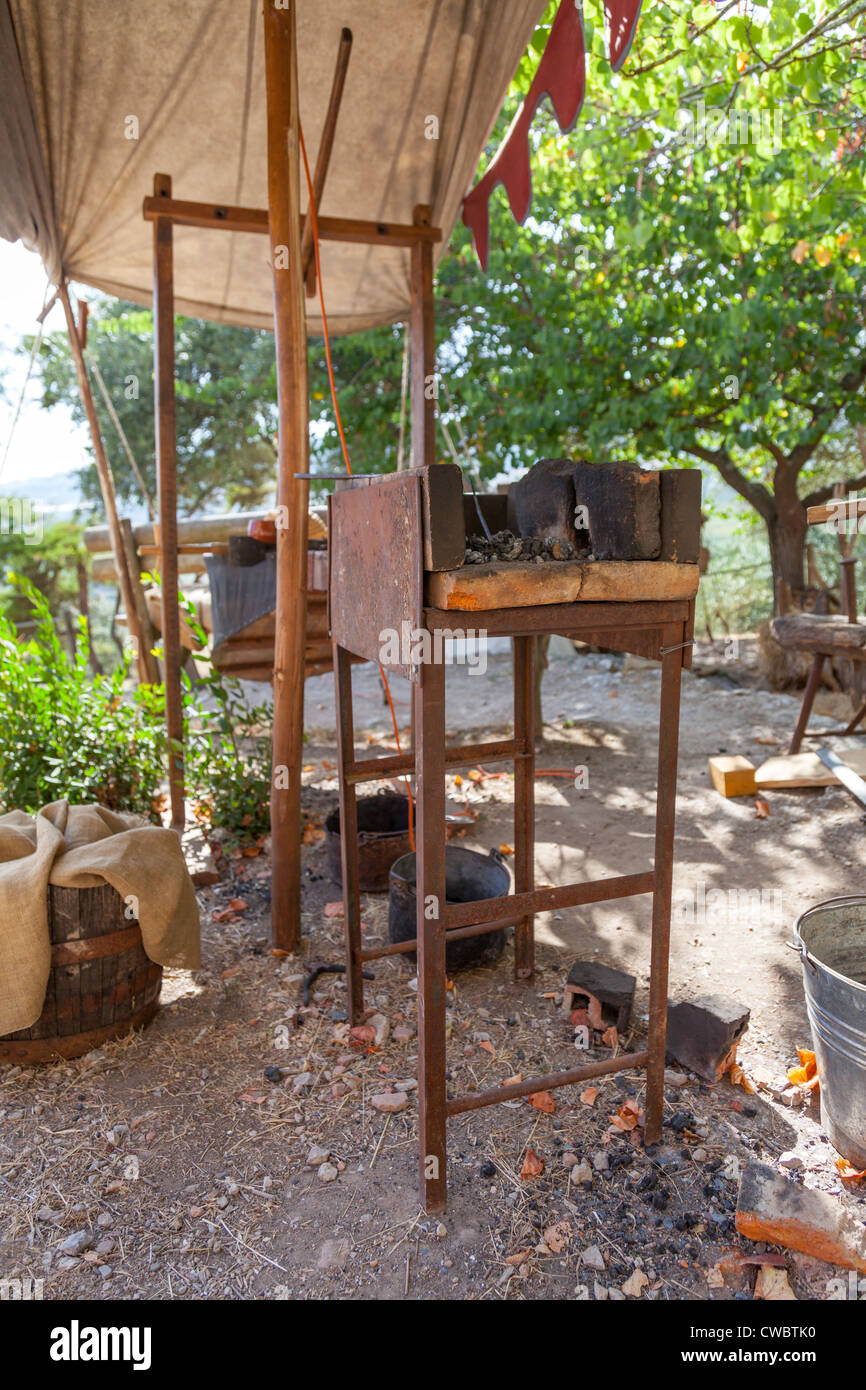 forge in a blacksmith tent in the reenactment of a medieval fair