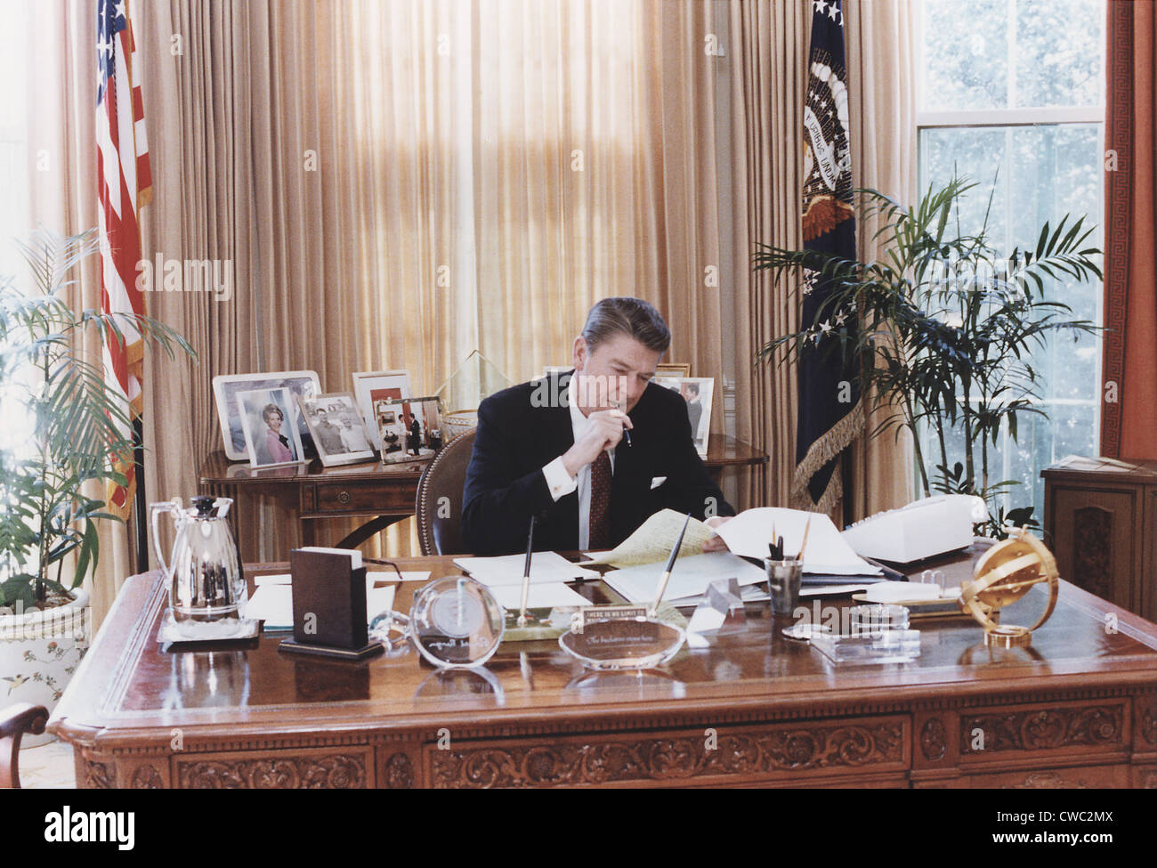 oval office desks. president reagan working at his oval office desk shortly before delivering 1982 state of the union address to congress. jan desks