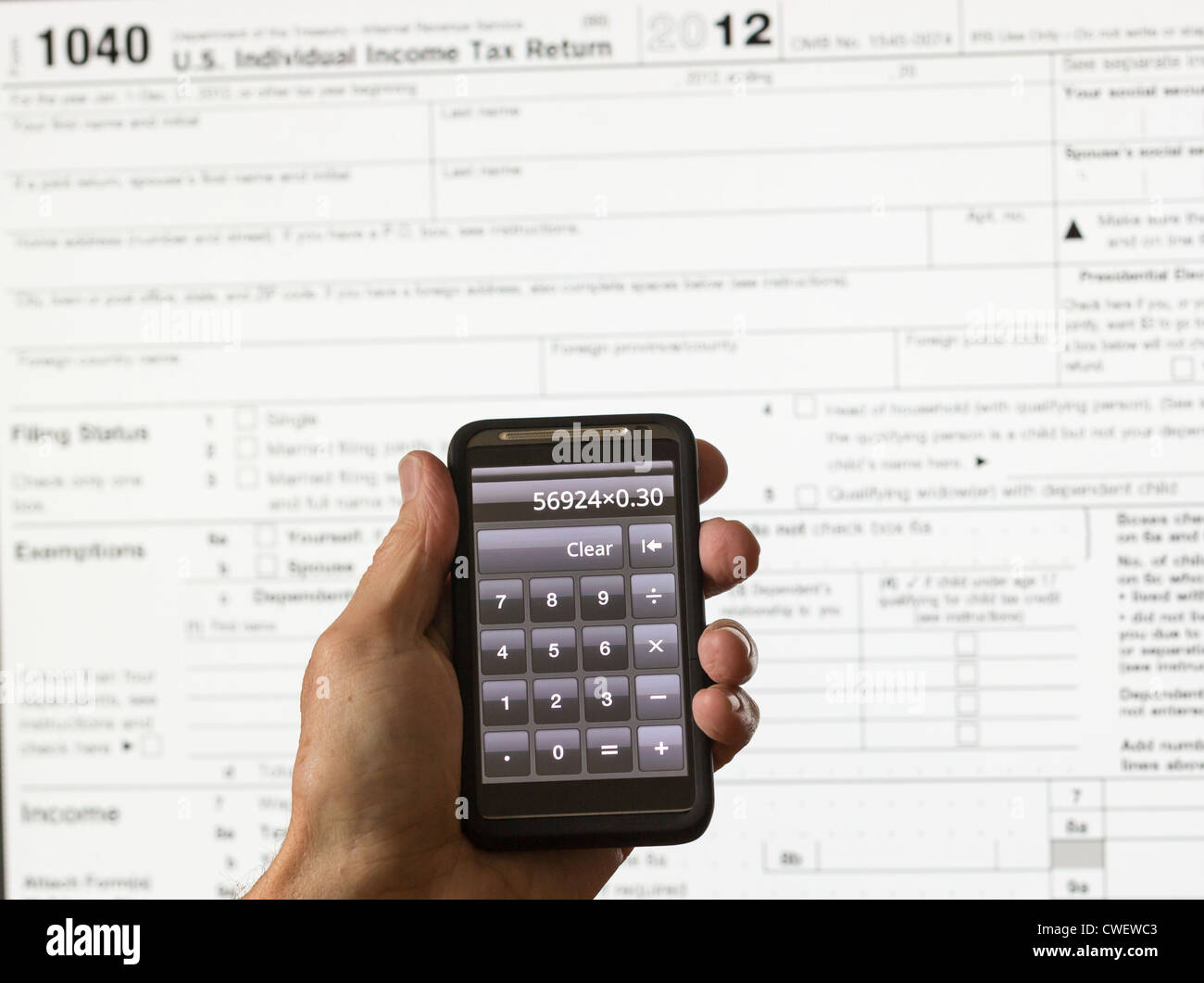 Electronic tax form 1040 for 2012 for us individual return on screen electronic tax form 1040 for 2012 for us individual return on screen with smartphone calculator falaconquin