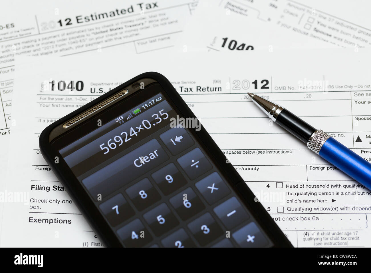Tax form 1040 for tax year 2012 for us individual tax return with tax form 1040 for tax year 2012 for us individual tax return with smartphone calculator falaconquin