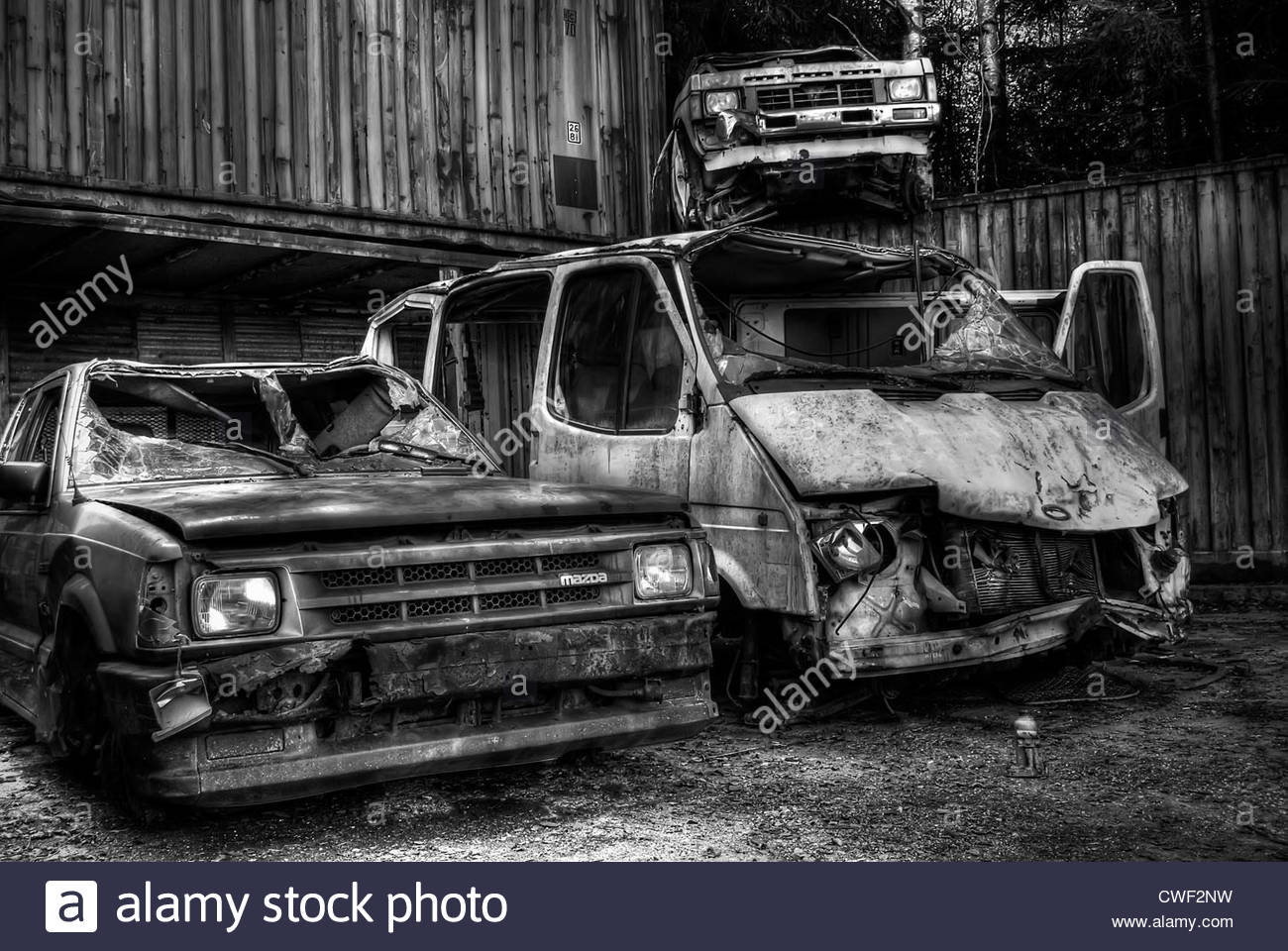 Old cars at a vehicle junkyard in Norway Stock Photo, Royalty Free ...
