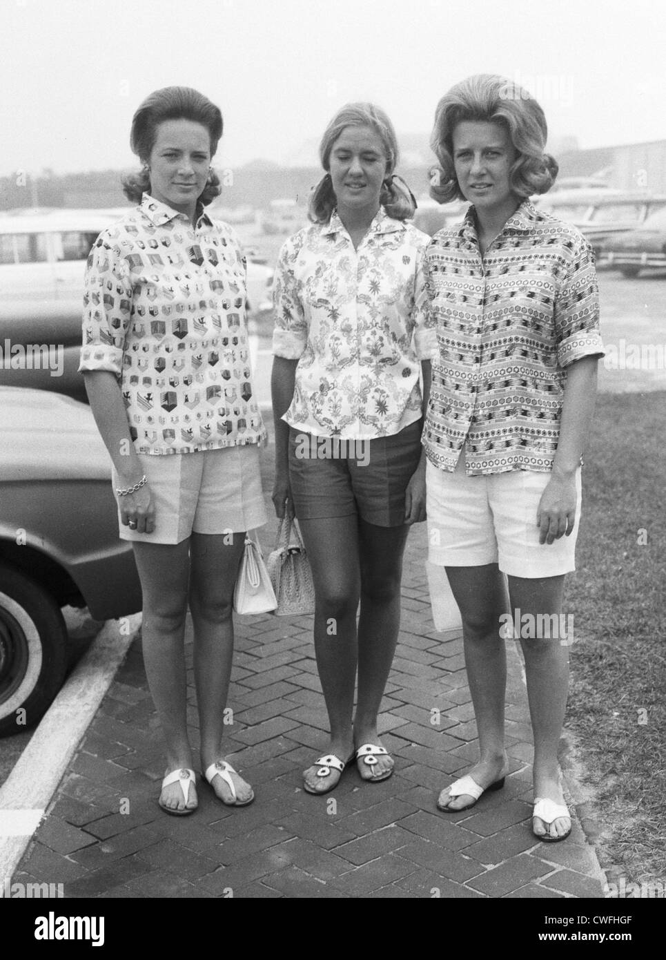 Robin lepard stands in between charlotte and anne ford daughters of henry ford ii