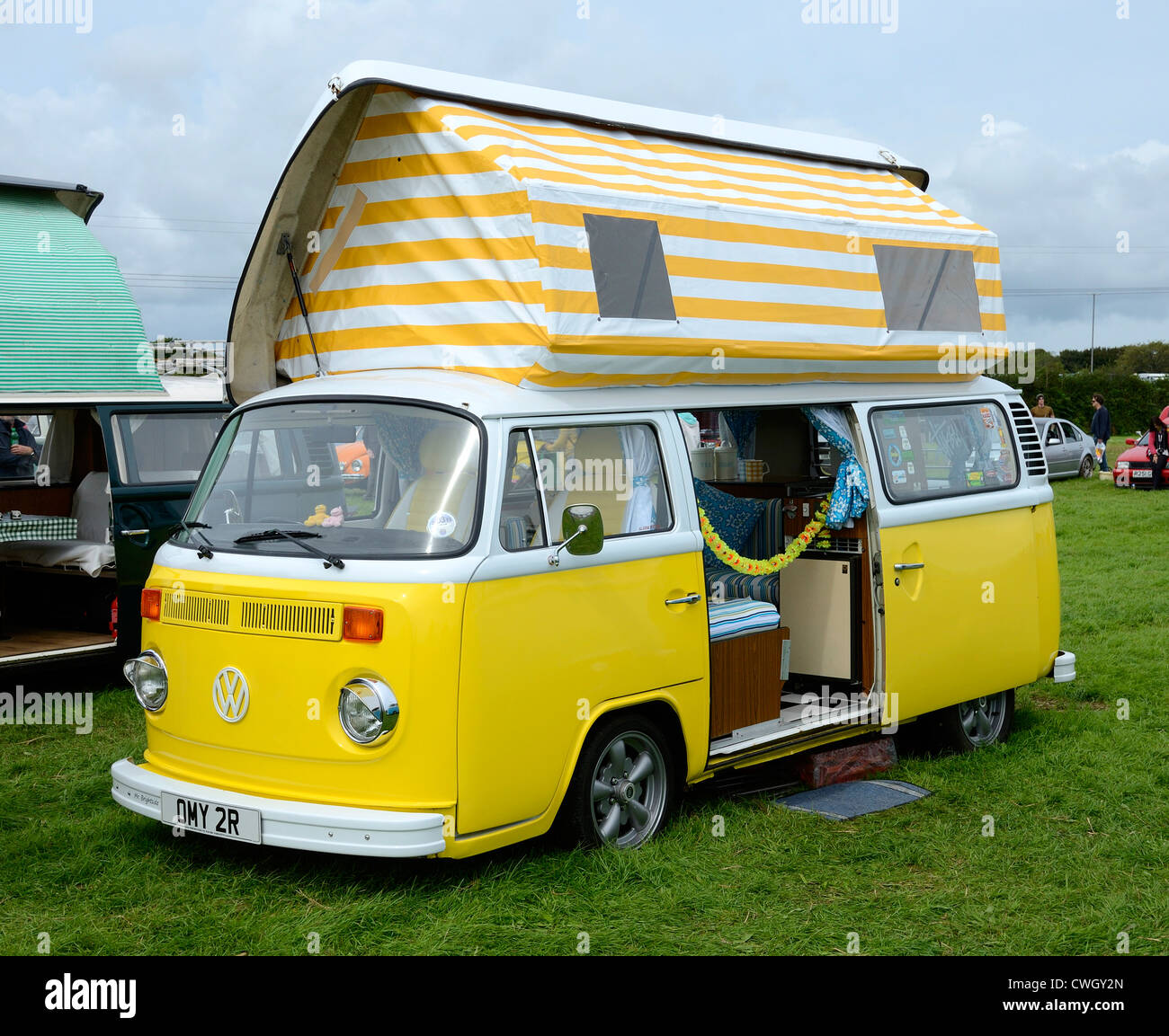 a vw camper van at a volkswagen rally in cornwall uk stock photo royalty free image 50159613. Black Bedroom Furniture Sets. Home Design Ideas