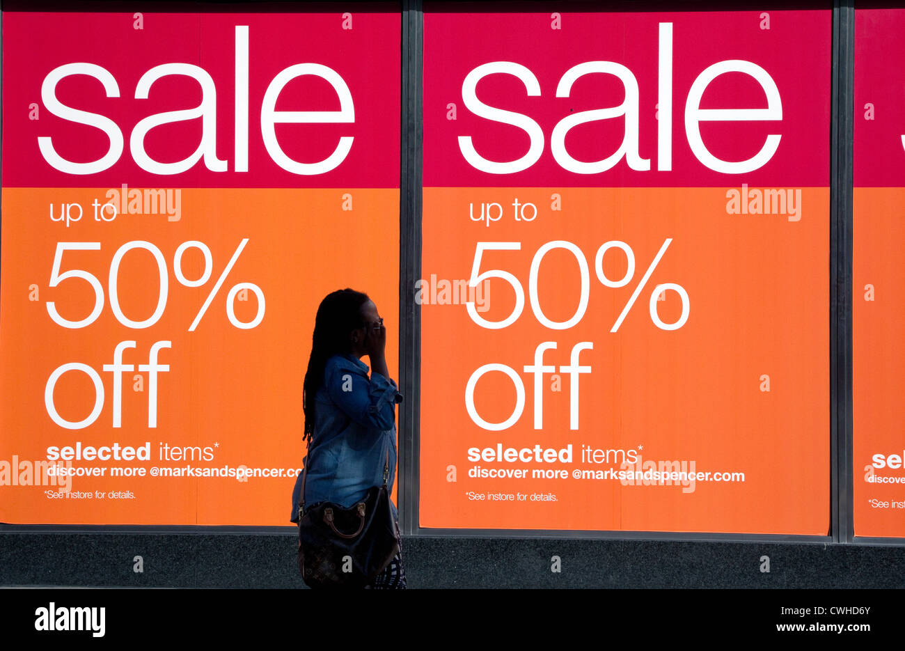 Sale posters in window of Marks & Spencer, Oxford Street ...