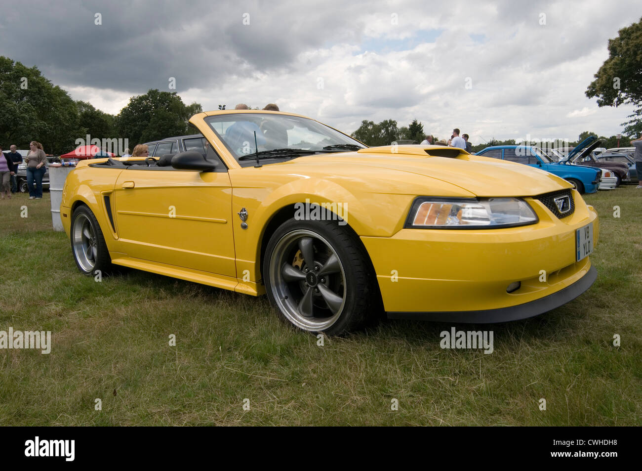 Ford mustang 2000 convertible soft top tops yellow stock image