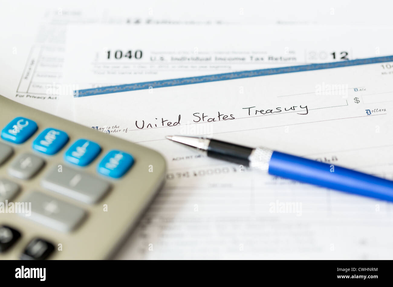 Tax form 1040 for tax year 2012 for us individual tax return with tax form 1040 for tax year 2012 for us individual tax return with pen and check falaconquin