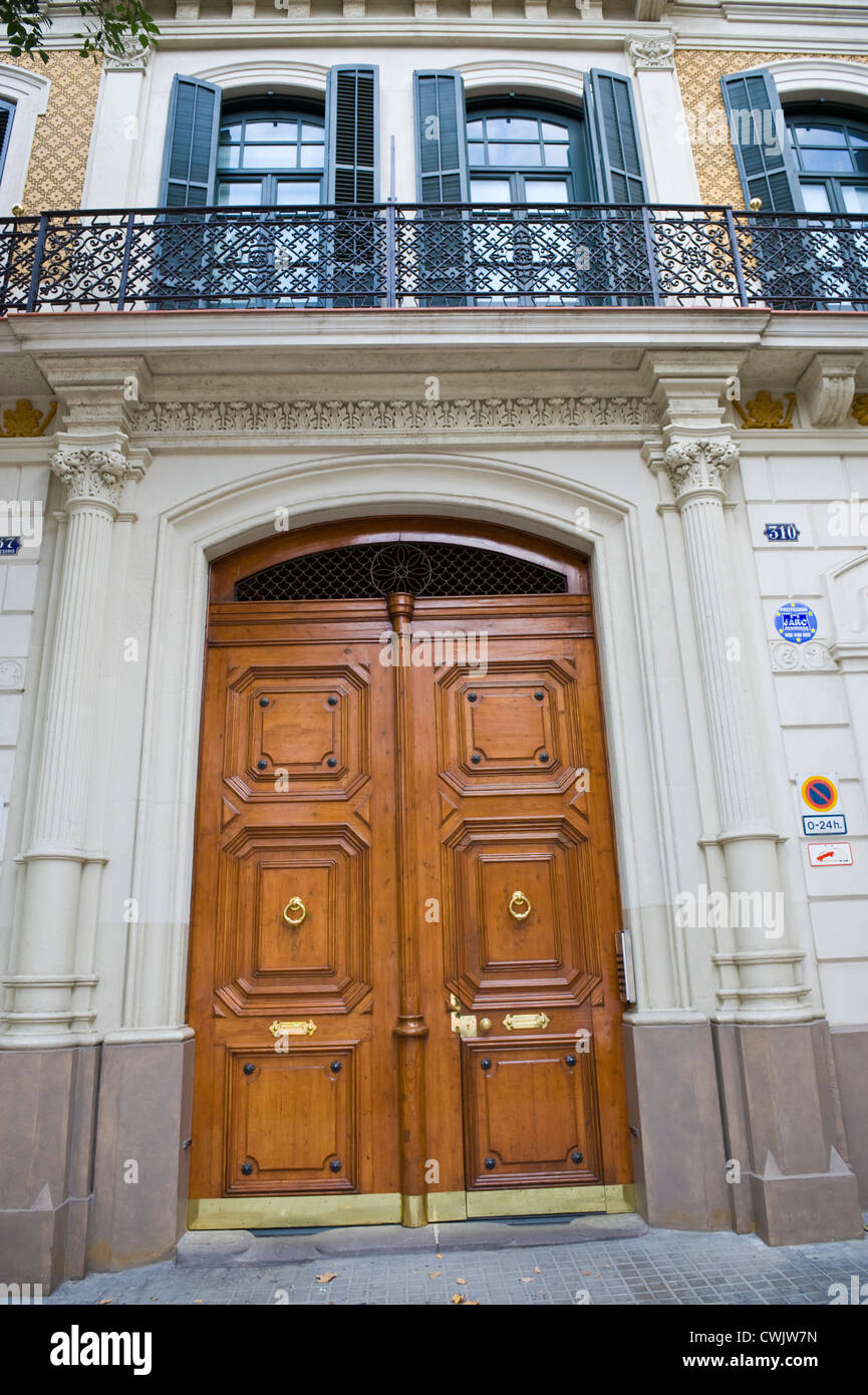 huge front door of apartment building in barcelona