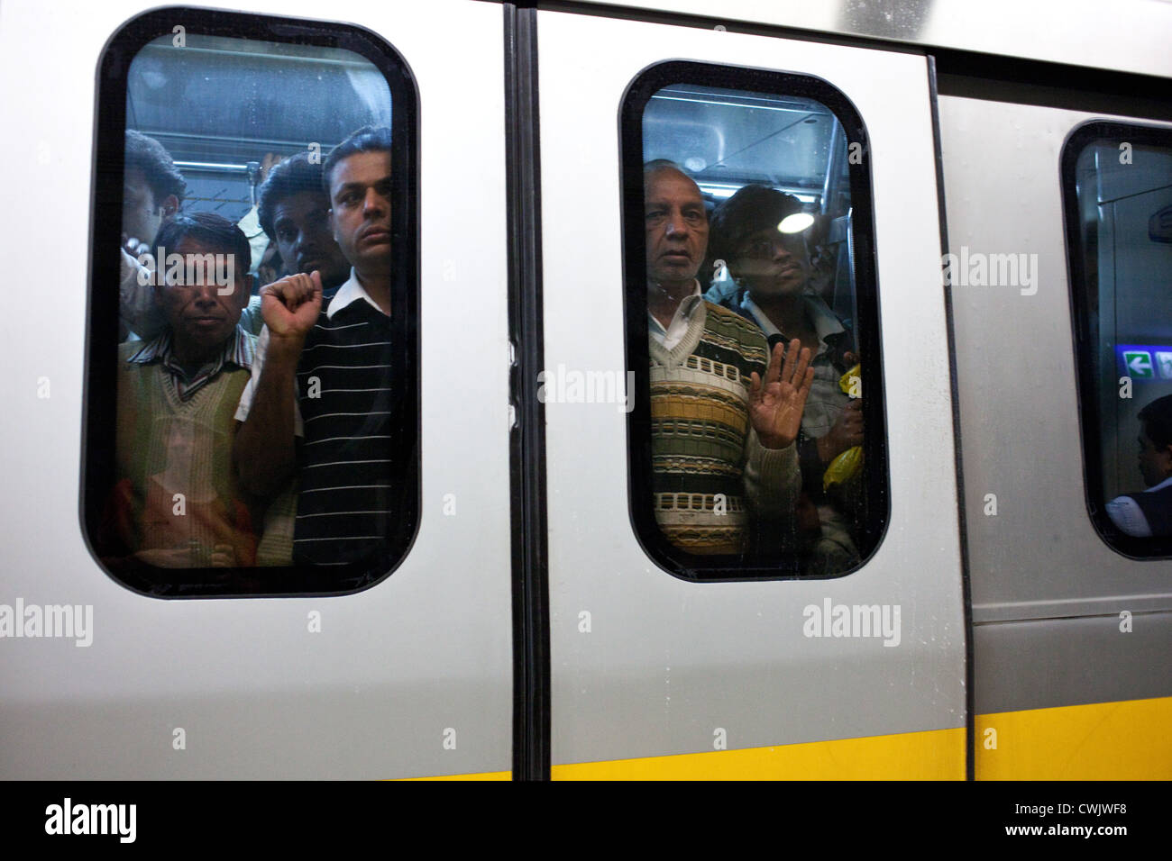A crowded carriage of metro train at the station in delhi india stock photo royalty free image - Carrage metro ...