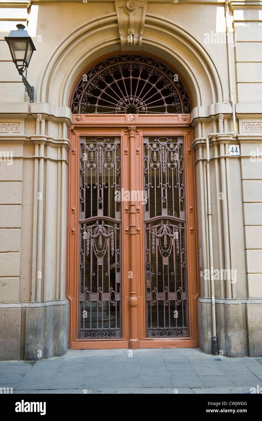 Apartment Building Door huge front door of apartment building in barcelona, catalonia