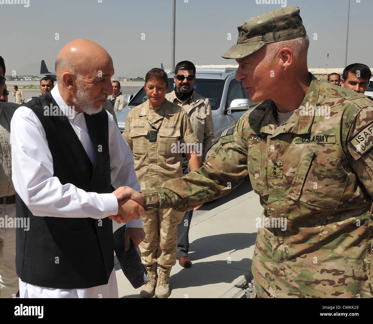 us army lt general james terry greets afghan president hamid karzai on the flight line