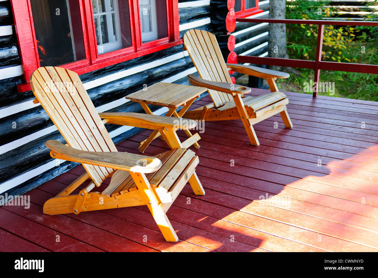 Wooden Log Cabin Cottage Porch With Adirondack Chairs