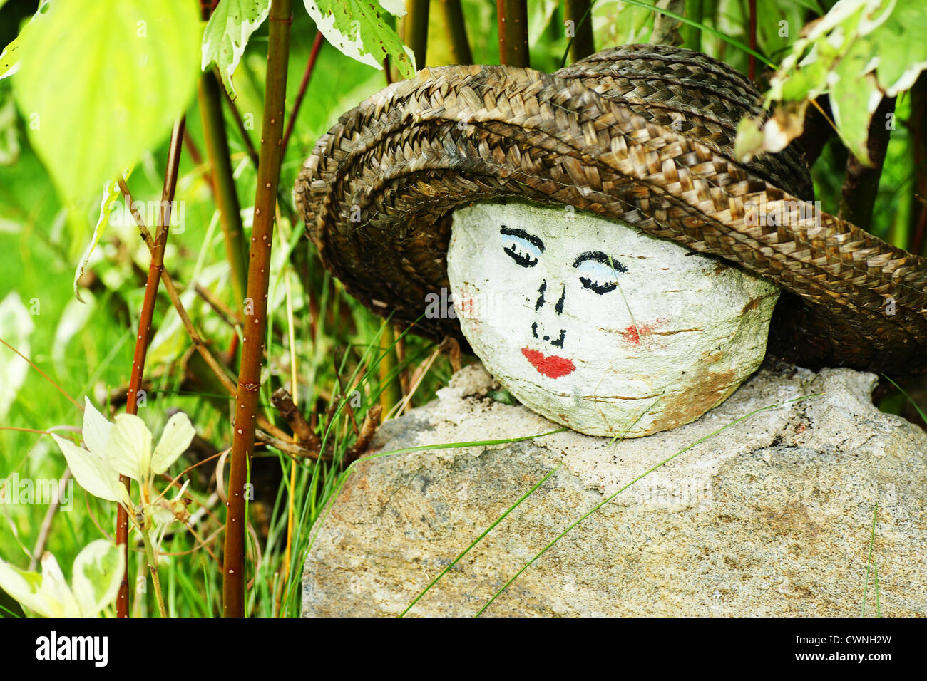 Homemade garden art - Original Homemade Garden Decoration With Round Painted Rock As A Woman S Face With Straw Hat Hidden