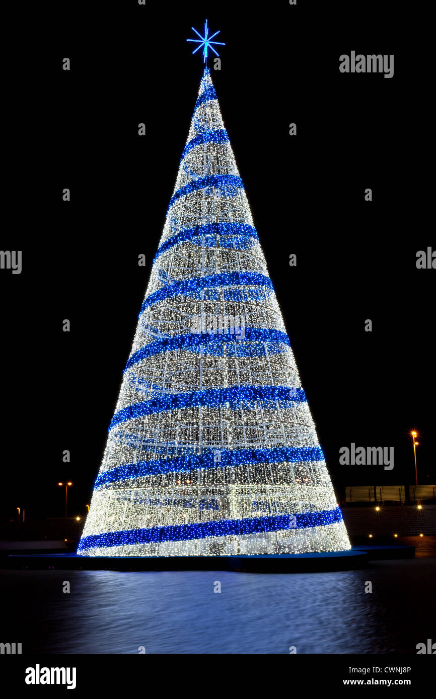 pine christmas tree figure with blue and white lights against a black background - White Christmas Tree Blue Lights