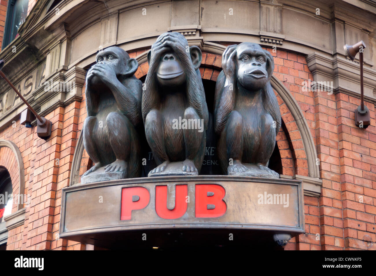 Three wise monkeys wooden ornaments - Three Wise Monkeys Pub Statues Sculpture Above Sign Sydney New South Wales Australia Stock