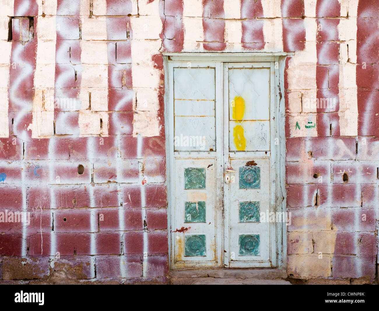 door-in-a-wall-with-numerous-patterns-an