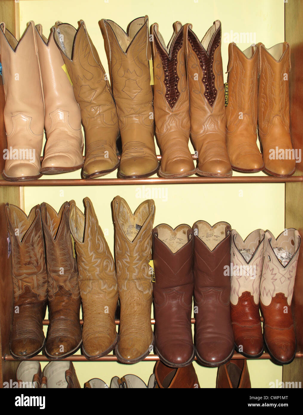 Rack of cowboy boots in thrift store Stock Photo, Royalty Free ...