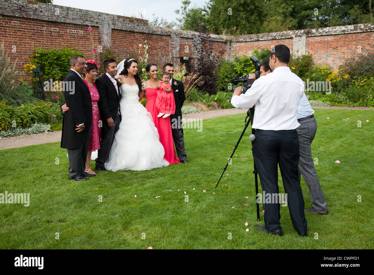 Wedding photographer taking pictures of the bride and for How to take wedding photos