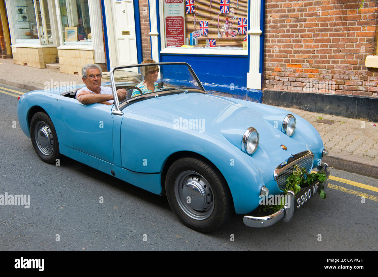 Austin Healey Frogeye Sprite in parade of vintage cars at opening of ...