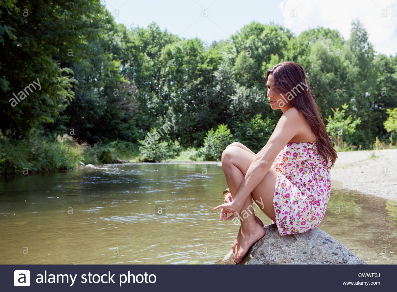The scene girl sitting on rock