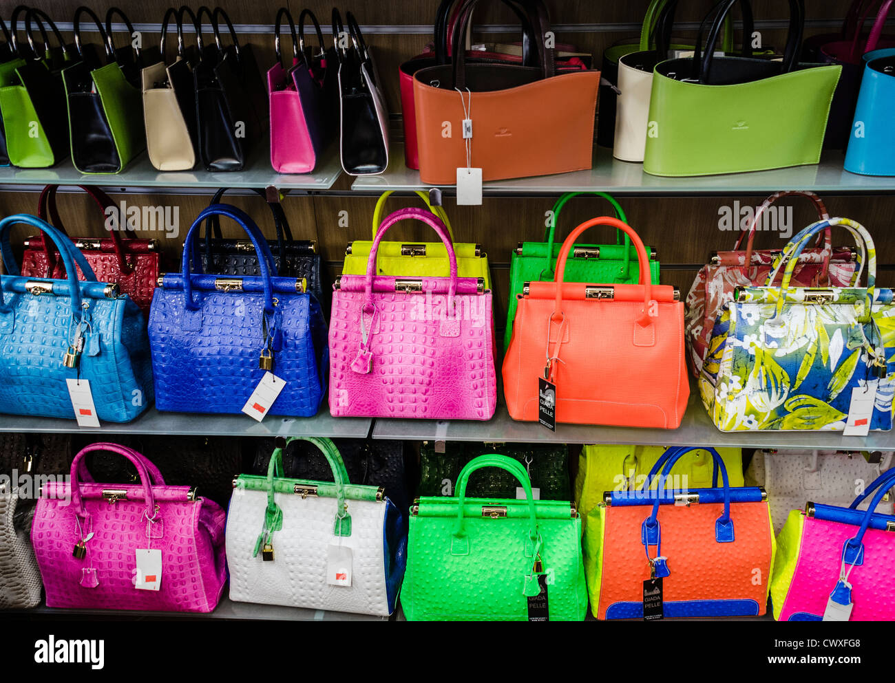 Colorful Leather Handbags in a shop in Tuscany, Italy Stock Photo ...