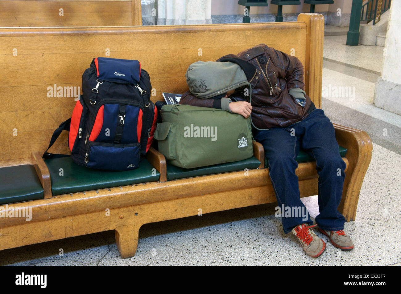 sleeping-male-traveler-taling-a-nap-on-a