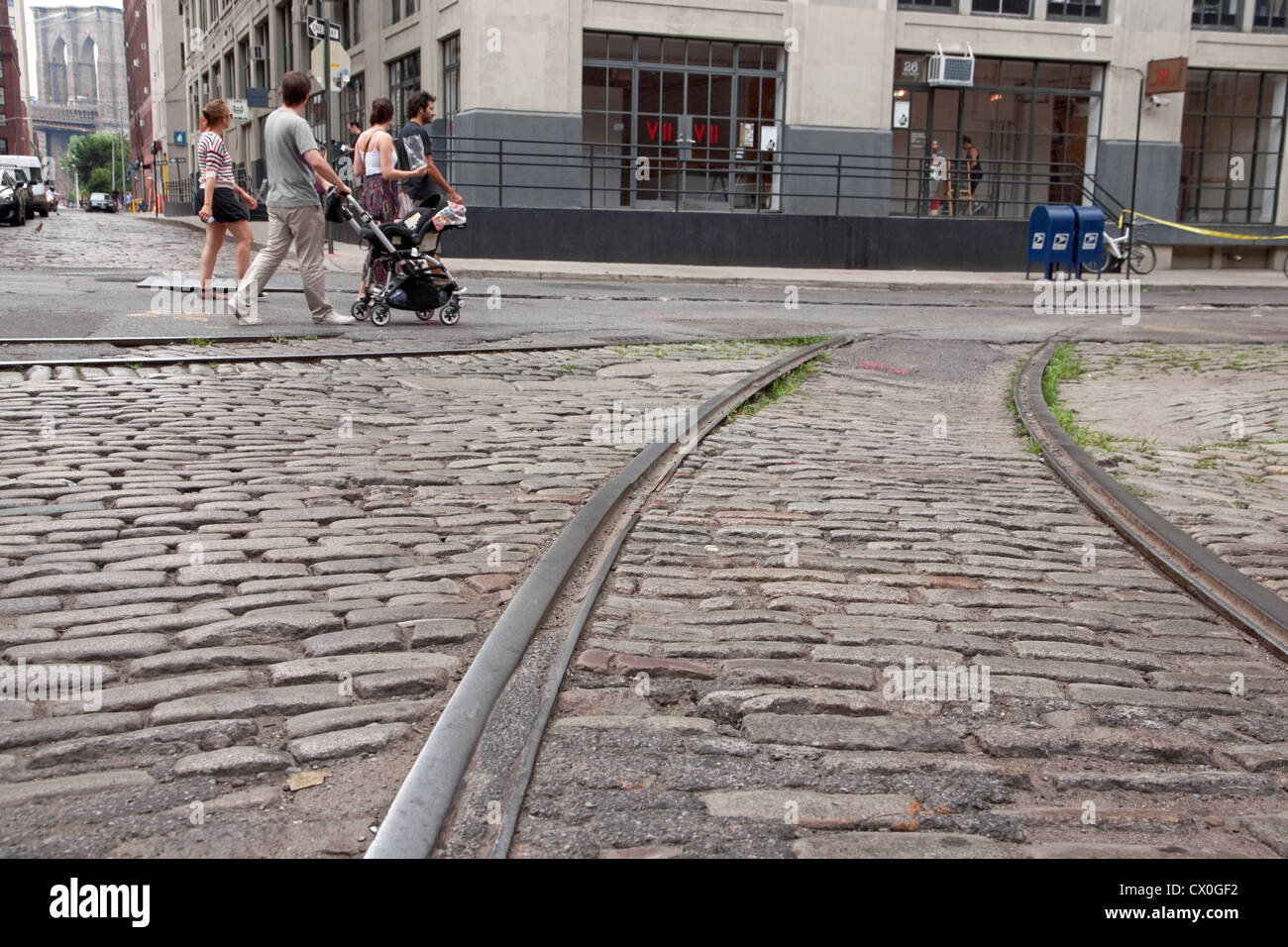 Tourists stroll along old cobblestone streets trolley for Old house tracks