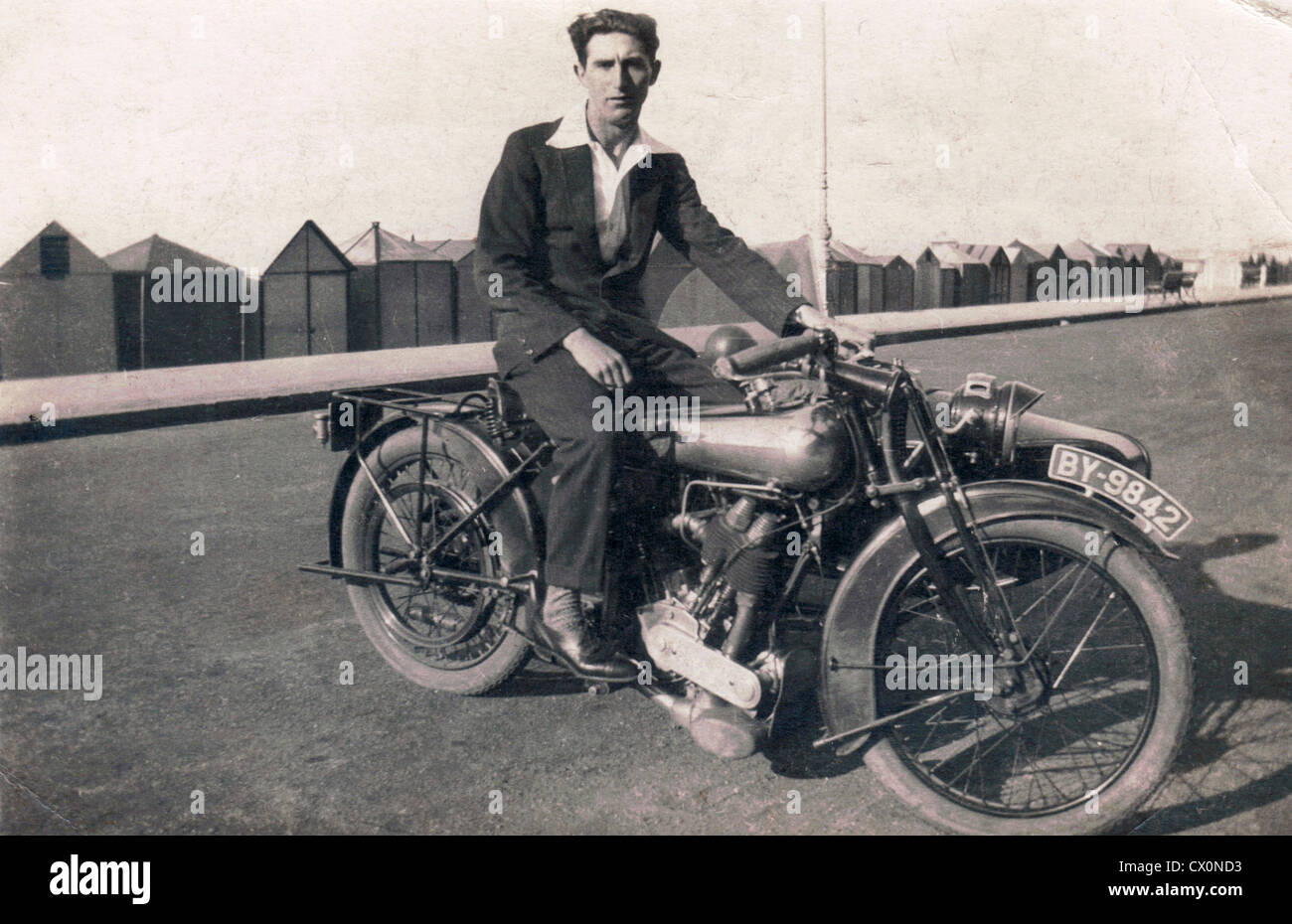 Motorcyclist on a brough superior motorcycle with sidecar combination on the seaside promenade in the