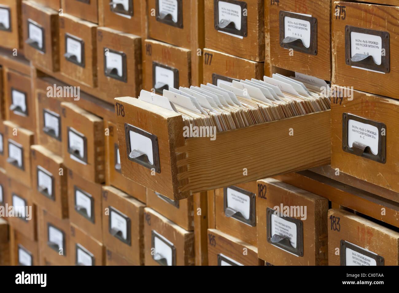 database concept. vintage cabinet. library card or file catalog ...