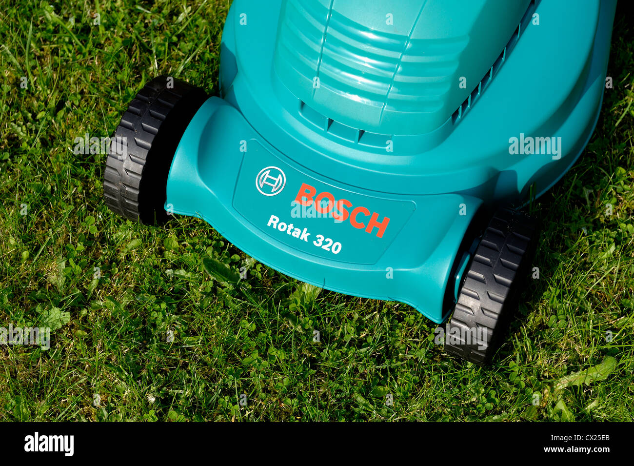 bosch rotak 320 electric rotary lawnmower stock photo royalty free image 50450019 alamy. Black Bedroom Furniture Sets. Home Design Ideas