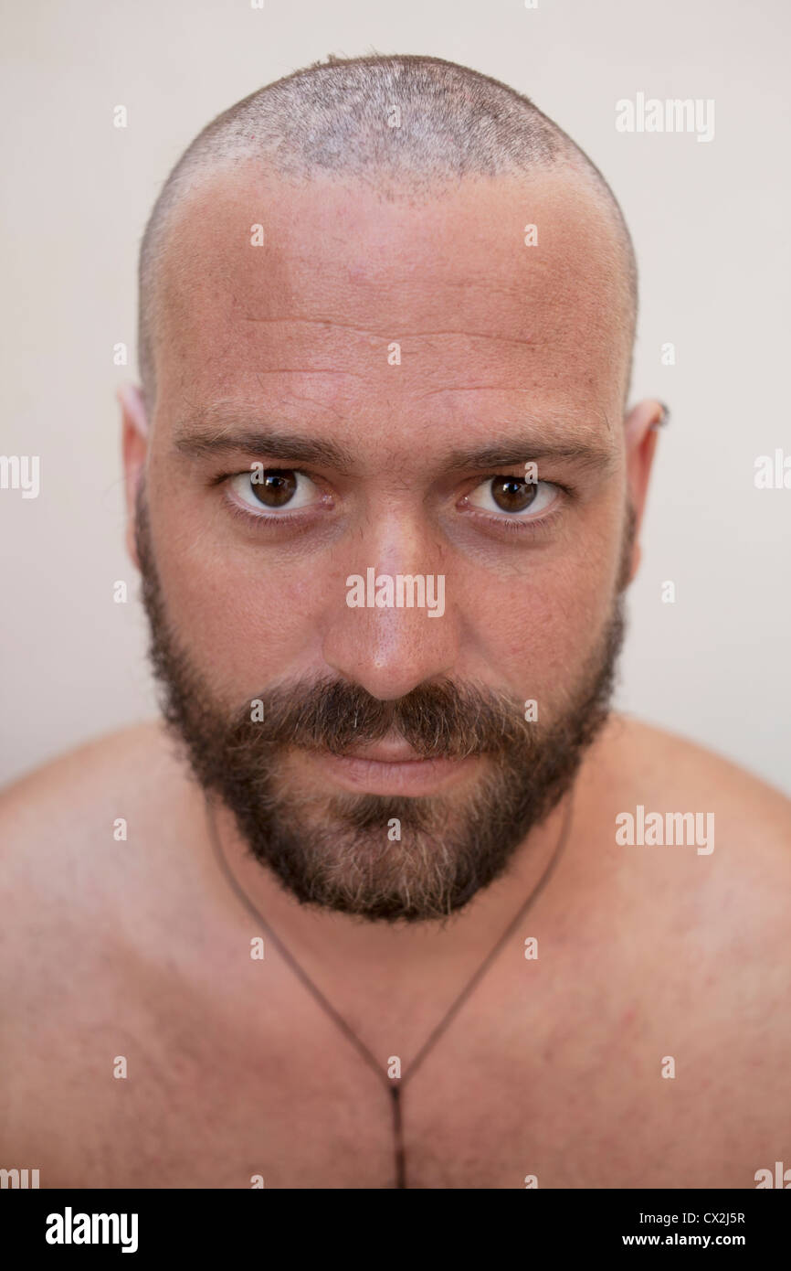 Pleasing White Young Man With Shaved Head And Long Beard Stock Photo Short Hairstyles For Black Women Fulllsitofus