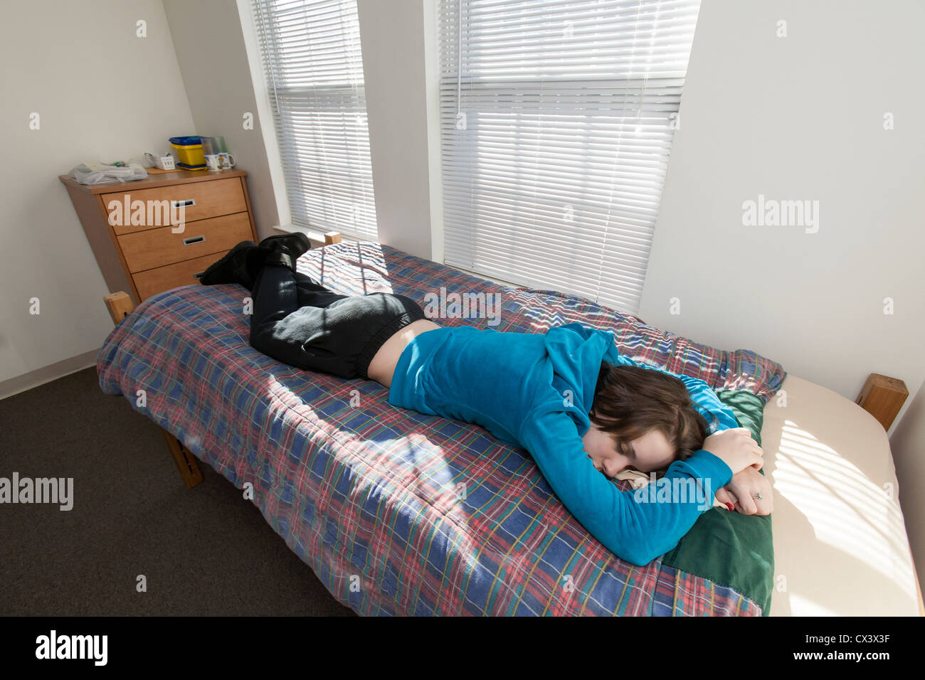 A Female College Student Lies On Her Bed In Her Dorm Room At College Or  University. Part 45