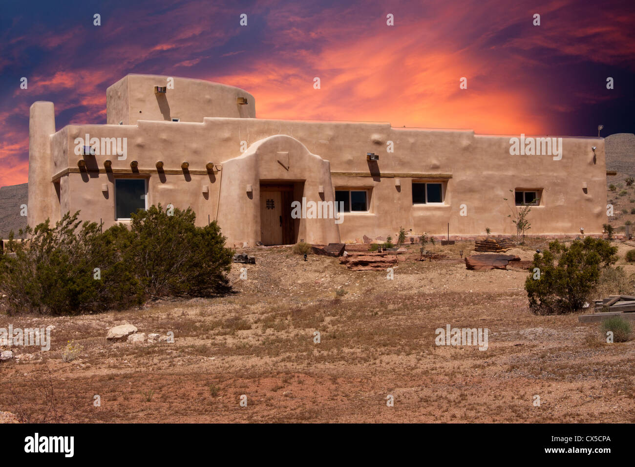 Adobe House In Nevada Desert With Dramatic Sunset Stock