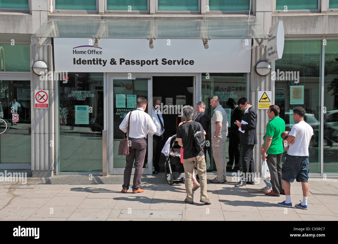 people queuing outside the identity and passport service. Black Bedroom Furniture Sets. Home Design Ideas