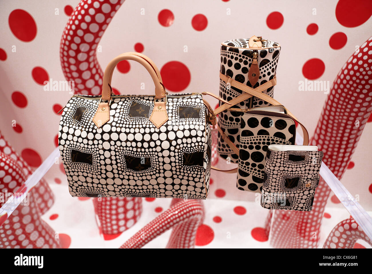 louis vuitton bag stock photos louis vuitton bag stock images handbags in louis vuitton store at ion orchard with collection by japanese artist yayoi kusama