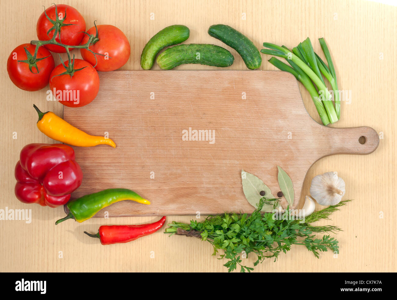 Stock Photo   Vegetables And Spices Border And Empty Cutting Board