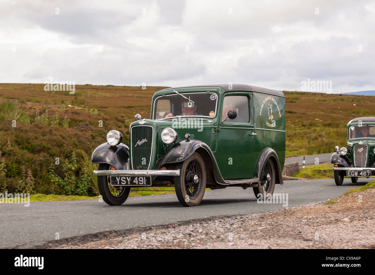 A Vintage Austin Classic Car Driving Through The Yorkshire Dales