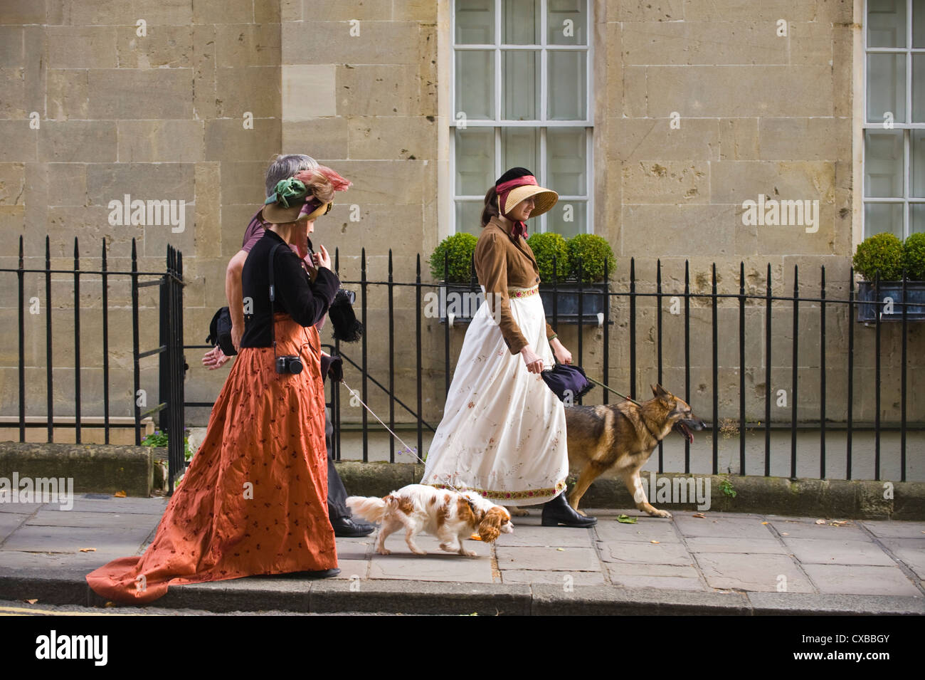Two women in Regency costume walking dogs through Bath city centre  during the 2012 Jane AustenWoman walking in Bath on a rainy night  A lady walks by Pulteney  . Dog Walkers Bath Area. Home Design Ideas