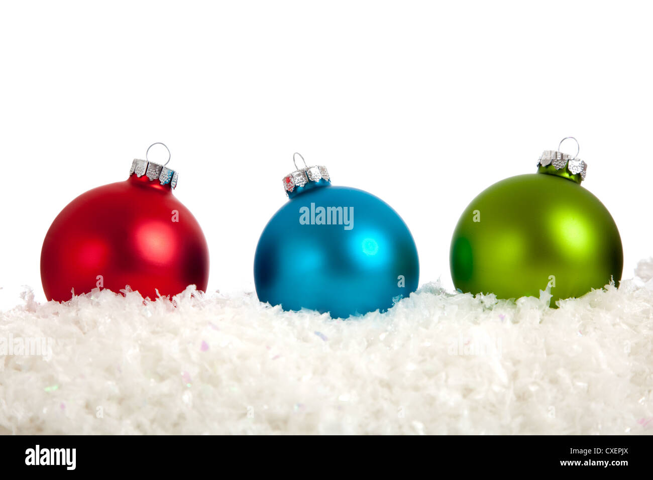 red blue and green christmas ornaments on a white