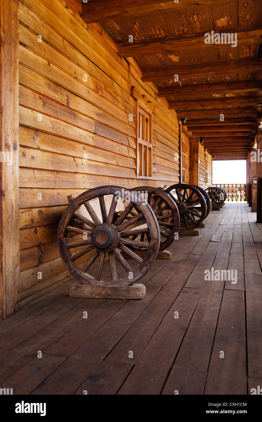 inside of a old wild west saloon a front view of antique wagon wheel stock photo royalty free. Black Bedroom Furniture Sets. Home Design Ideas