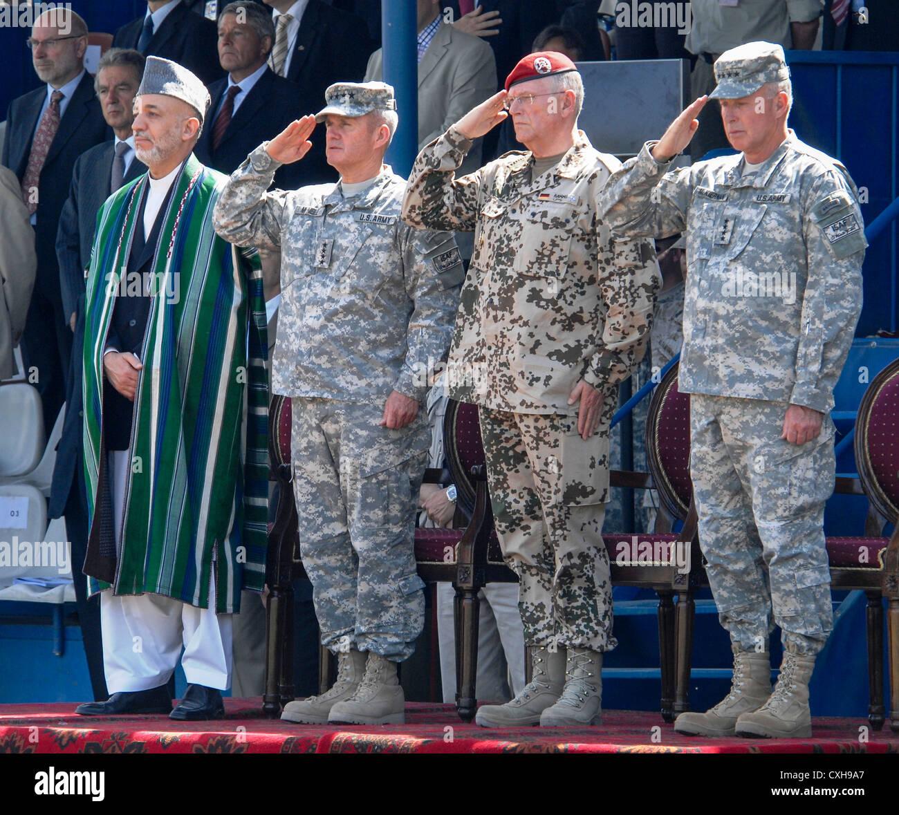afghan president hamid karzai l stands alongside outgoing isaf commander general dan k