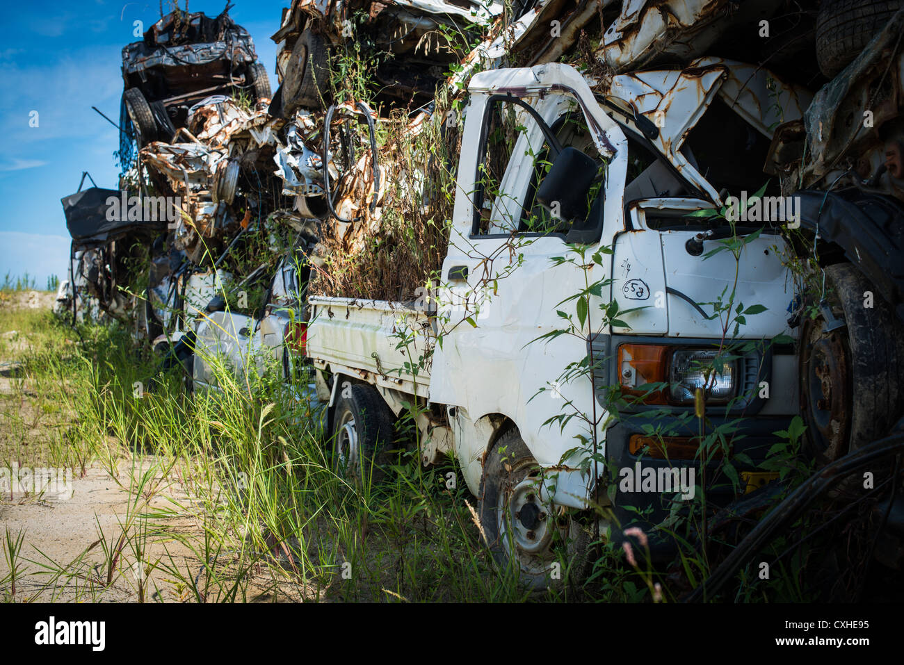 Beachside car graveyard for vehicles destroyed by the 2011 ...