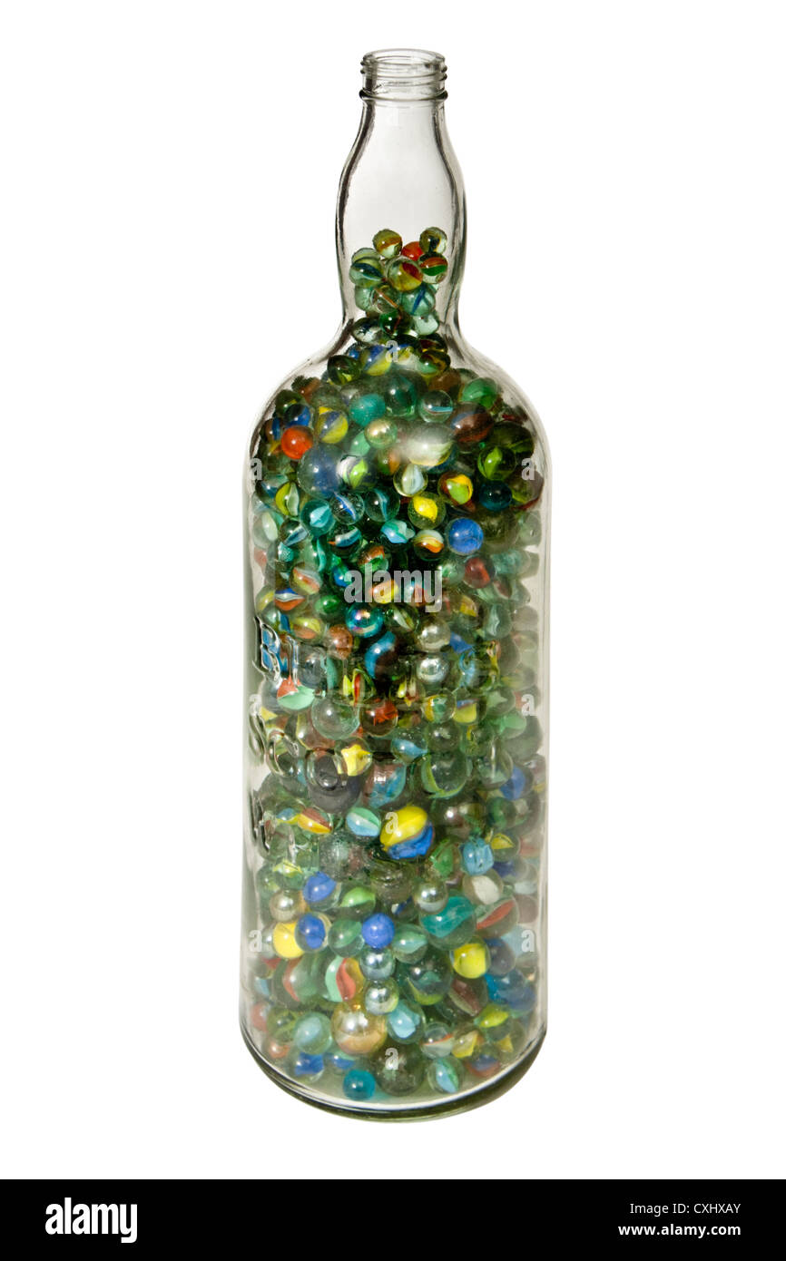 Large Scotch Whisky Bottle Full Of Marbles Stock Photo