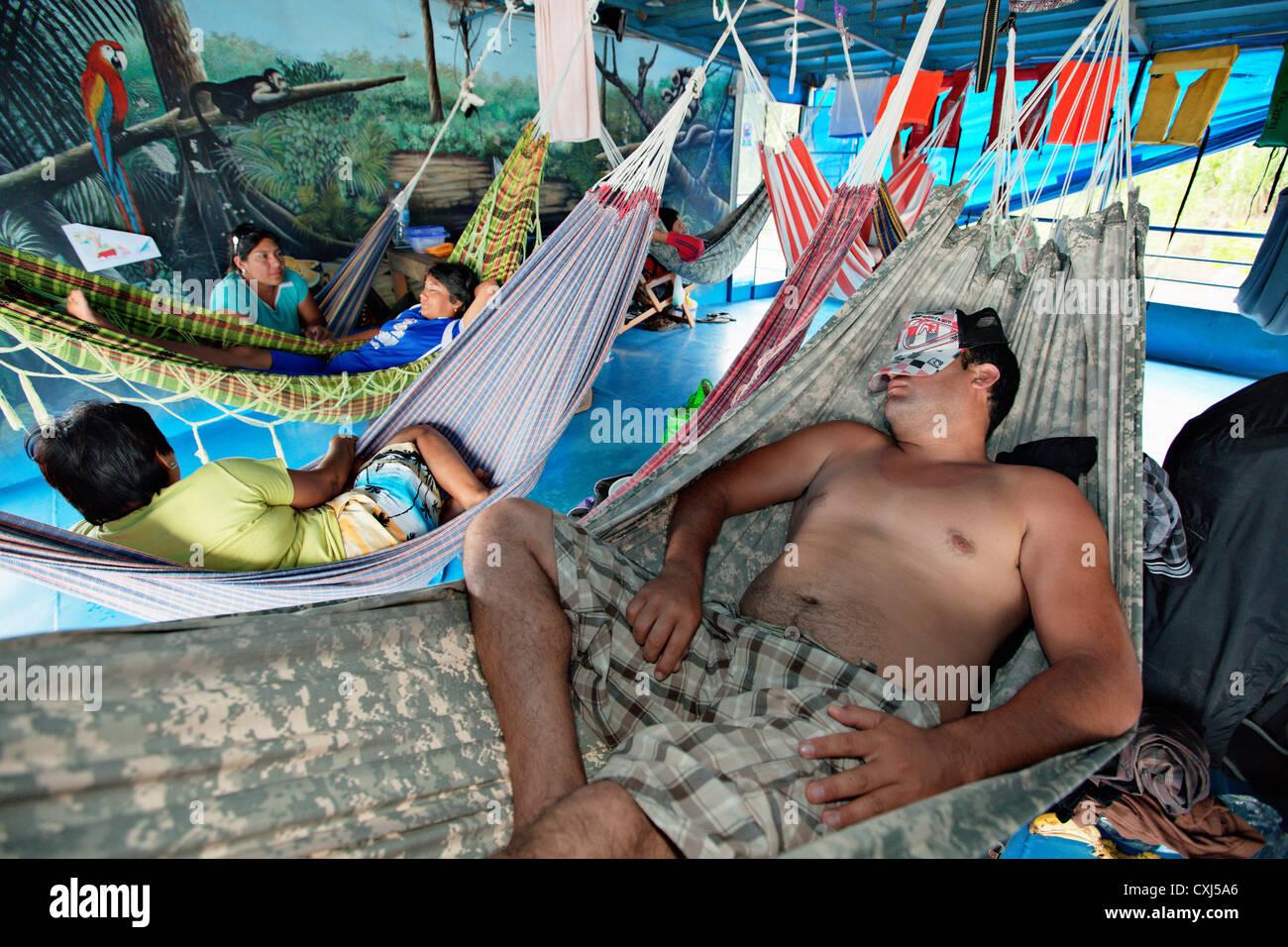 passangers sleep in hammocks in a river boat on amazon river peru passangers sleep in hammocks in a river boat on amazon river peru      rh   alamy
