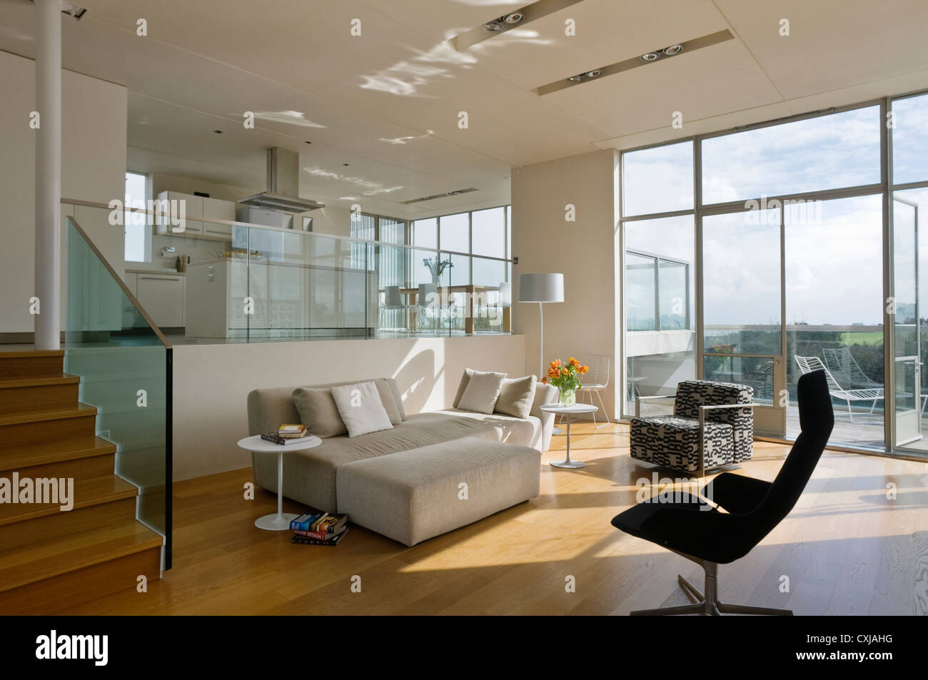 split-level open plan living room and kitchen stock photo, royalty