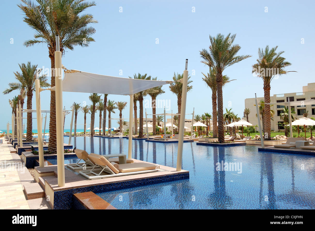 Huts at swimming pool of the luxury hotel saadiyat island abu dhabi uae