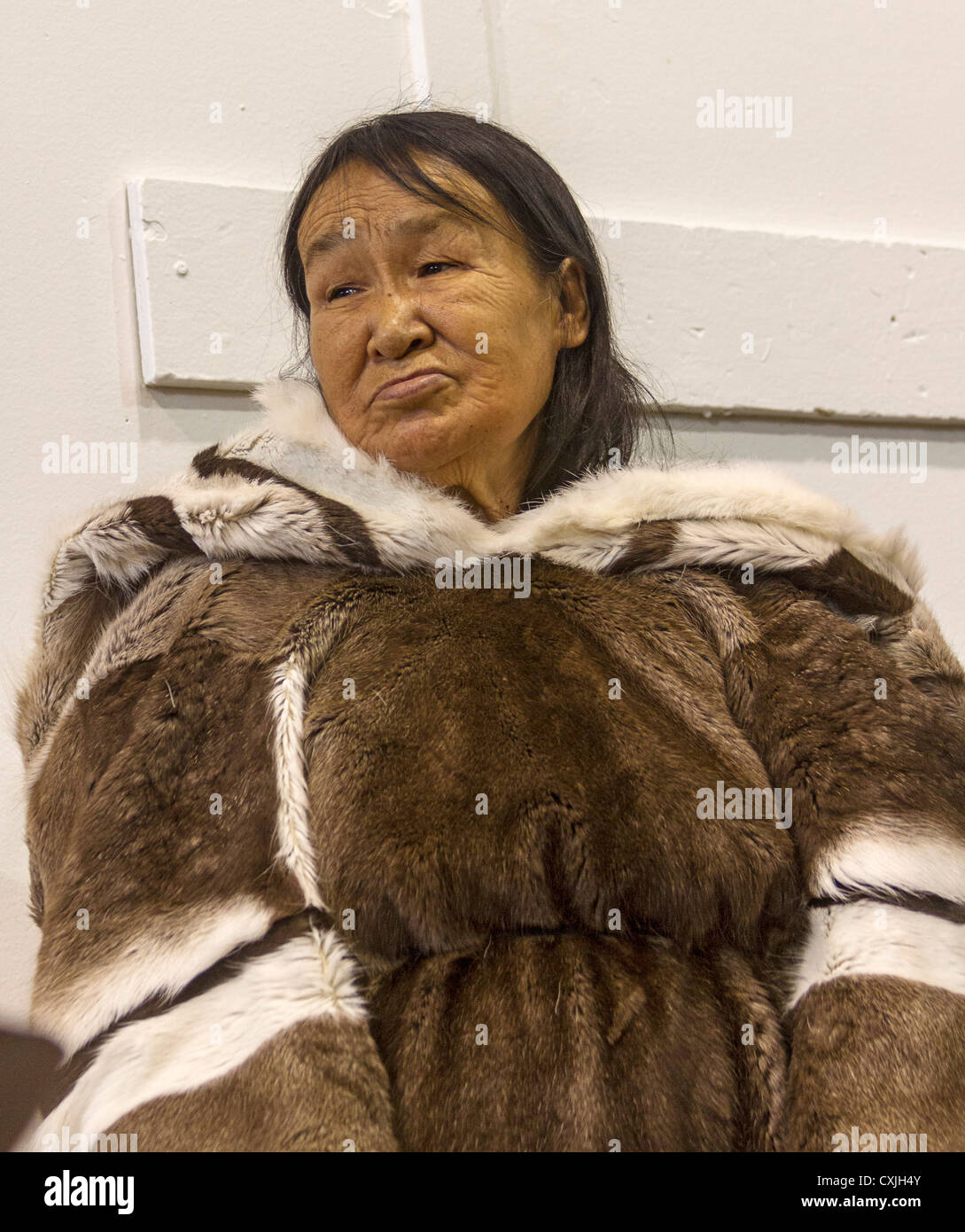 elderly inuit woman in traditional skin clothing grise fjord