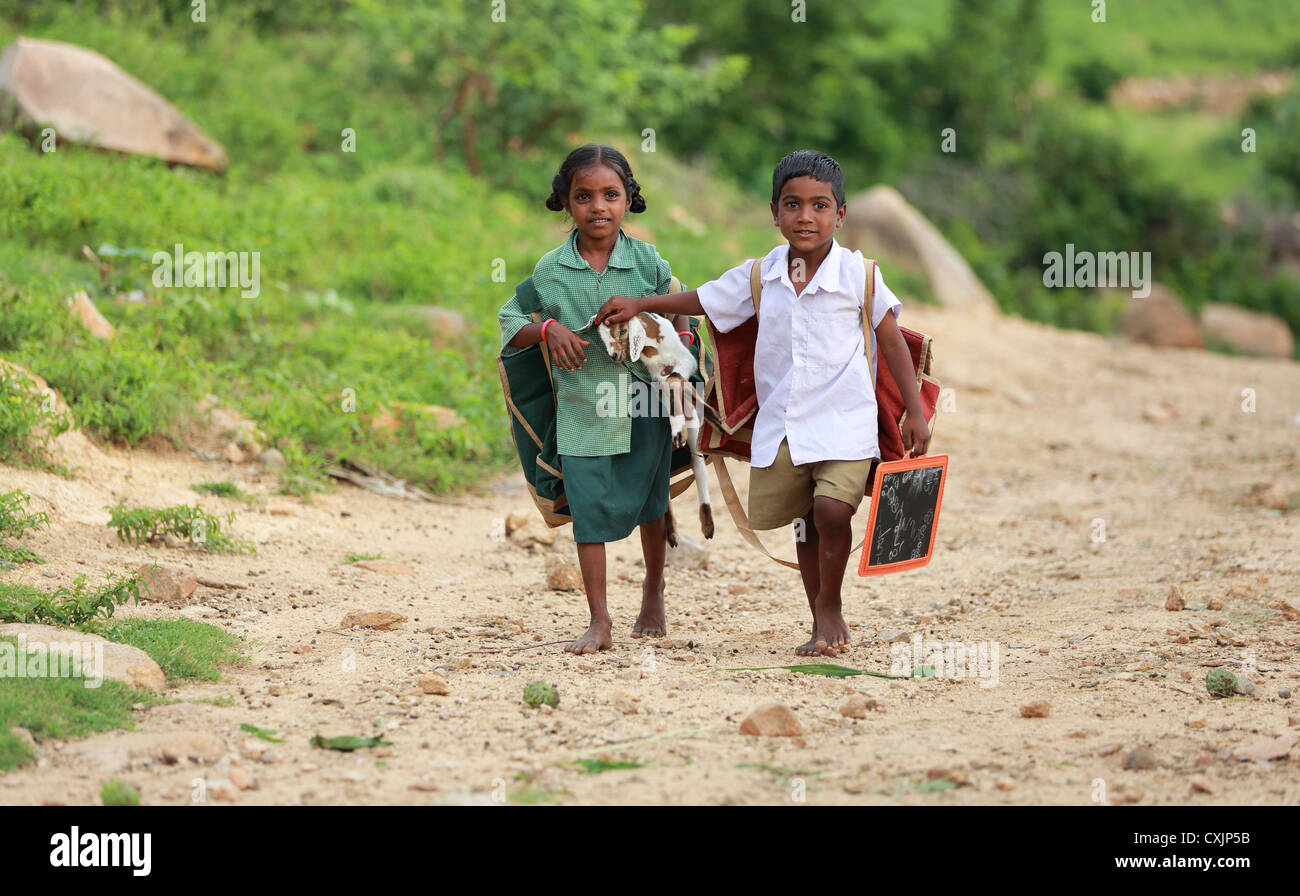 Indian School Children Going To School With A Little Pet