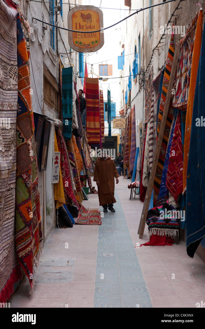 Hanging Rugs Moroccan Man Walking Down Arrow Street With Hanging Rugs And