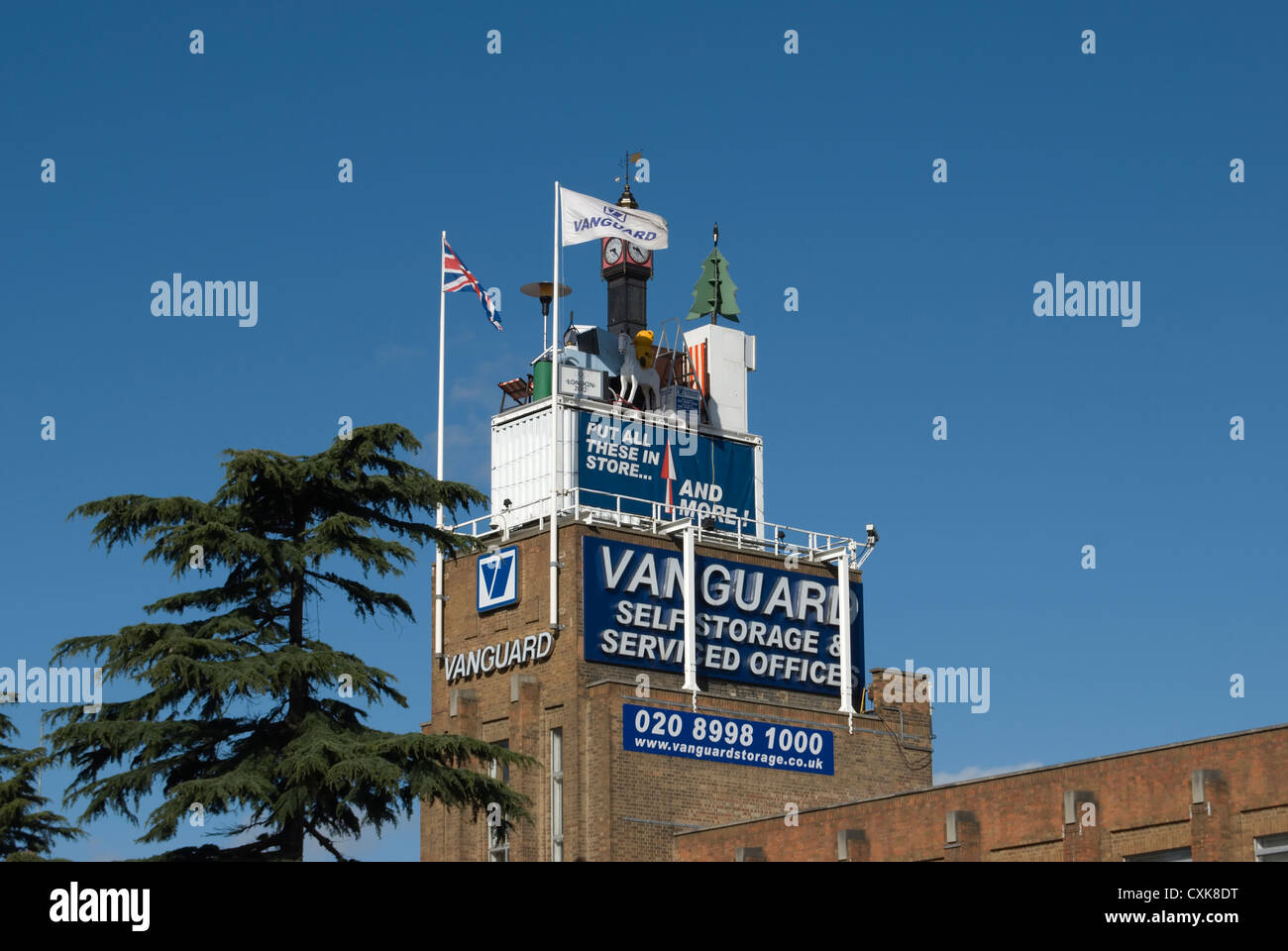 Stock Photo   Branch Of Vanguard Self Storage With Pseudo Household Items  Placed On Roof To Be Visible From Road, Perivale, London, England