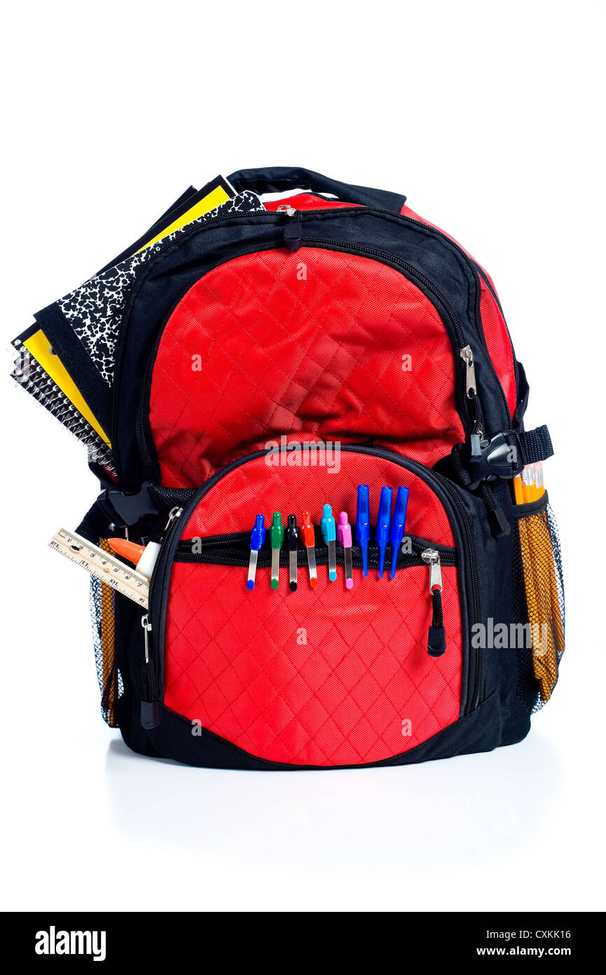 A red school back pack or book bag overflowing with school ...
